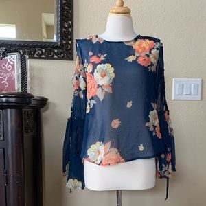 Floral sheer open arm blouse